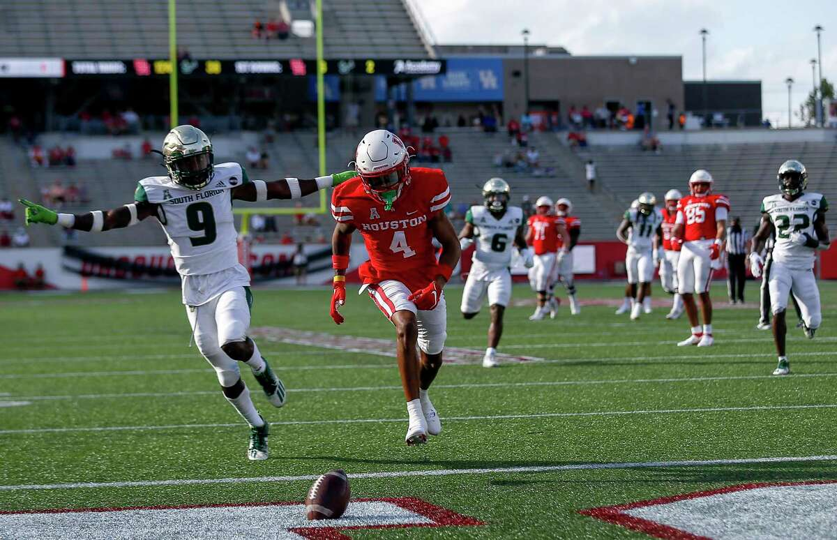 Houston Cougars wide receiver Nathaniel Dell (4) misses pass defended by South Florida Bulls defensive back KJ Sails (9) during the first quarter of an NCAA football game Saturday, Nov. 14, 2020, at TDECU Stadium in Houston.