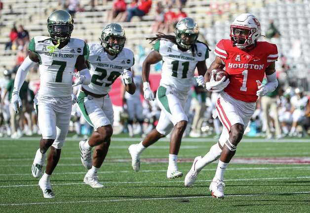 Houston Cougars wide receiver Bryson Smith (1) scores a touchdown while outrunning South Florida Bulls defensive back Mike Hampton (7), linebacker Brian Norris (29) and South Florida Bulls linebacker Dwayne Boyles (11) during the first quarter of an NCAA football game Saturday, Nov. 14, 2020, at TDECU Stadium in Houston. Photo: Jon Shapley, Staff Photographer / © 2020 Houston Chronicle