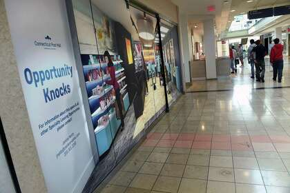 An empty store available for lease at the Connecticut Post Mall in Milford has a mural decorating the space on Oct. 14, 2020.