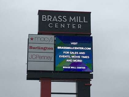 In this file photo, The sign at the entrance to the Brass Mill Center mall in Waterbury.