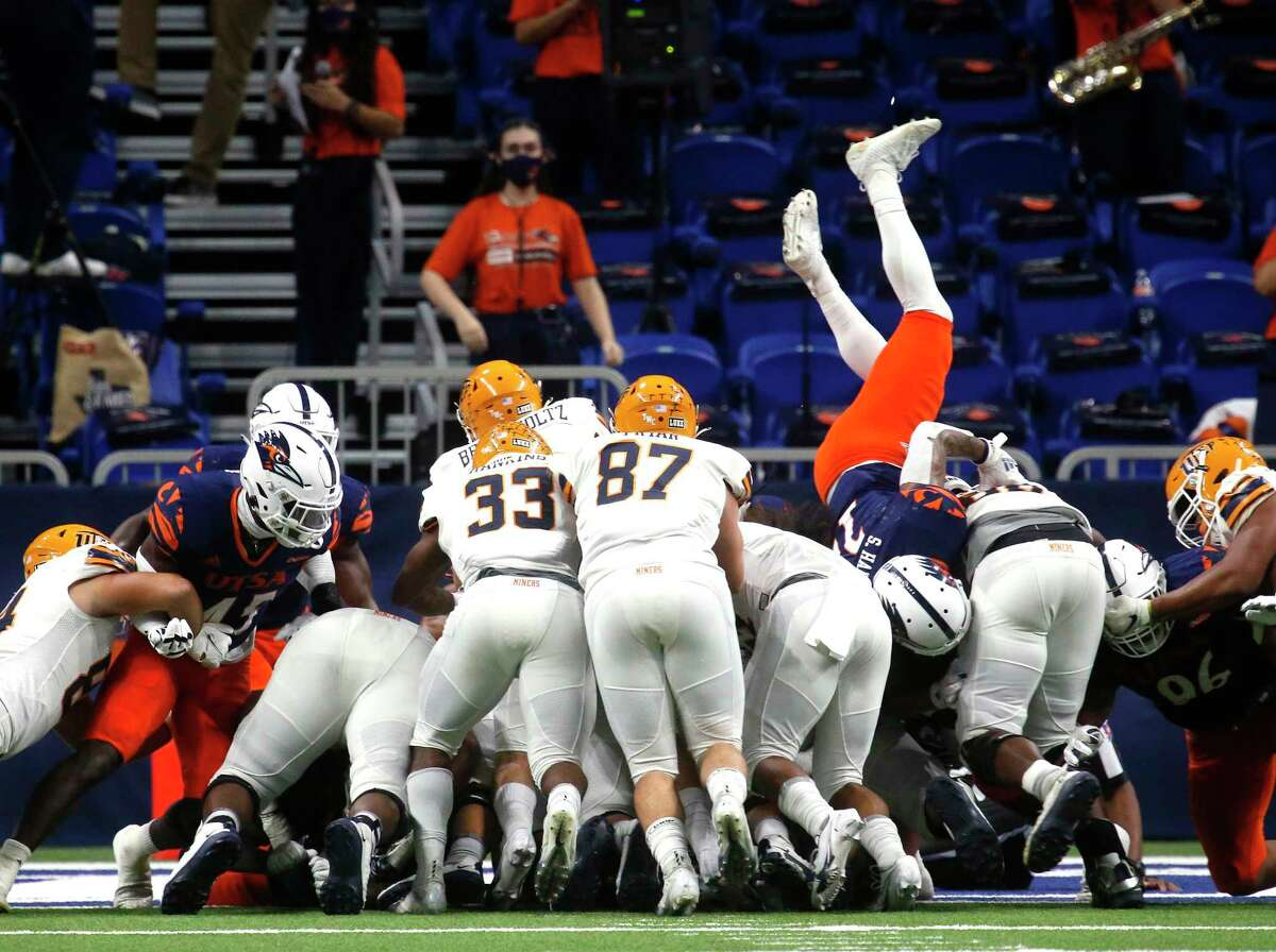 Despite the defense effort UTEP QB Gavin Hardison scores a touchdown in second quarter. UTEP at UTSA on Saturday, Nov.14, 2020 at the Alamodome.