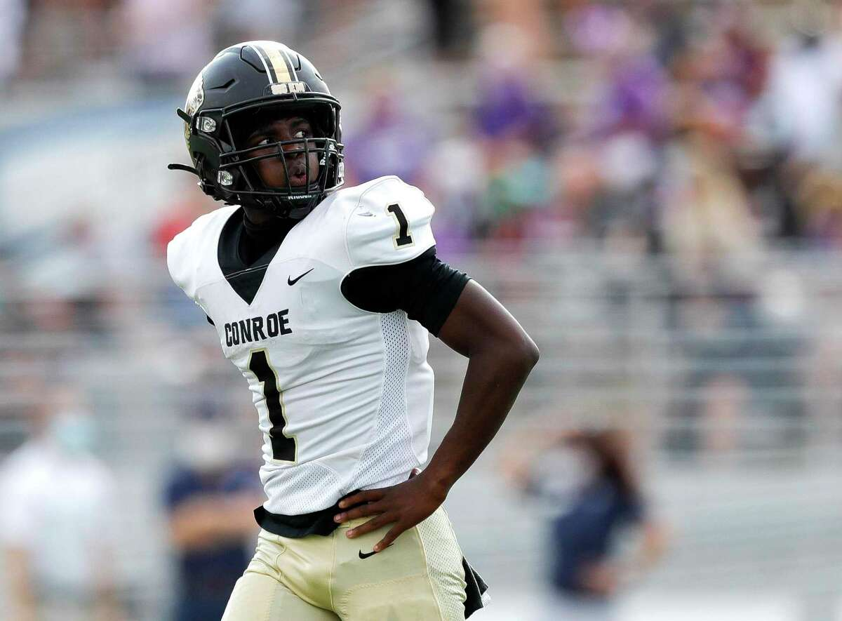 Conroe quarterback Jalen Williams (1) looks up at the scoreboard after going 3-and-out during the second quarter of a District 13-6A high school football game at Woodforest Bank Stadium, Saturday, Nov. 14, 2020, in Shenandoah.