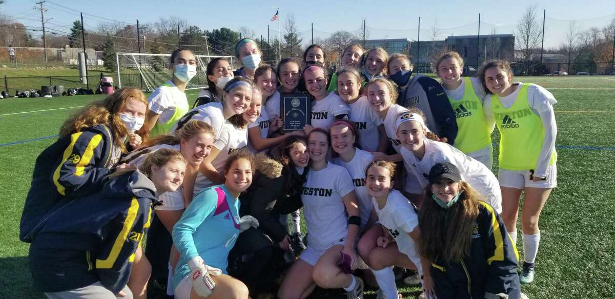 The Weston girls soccer team celebrates winning the South-West Conference South Division championship over Notre Dame-Fairfield on Saturday.