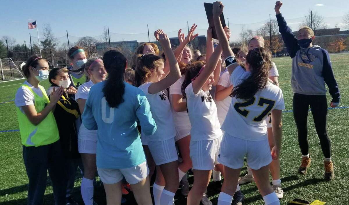 The Weston girls soccer team celebrates winning the South-West Conference South Division title over Notre Dame-Fairfield on Saturday.