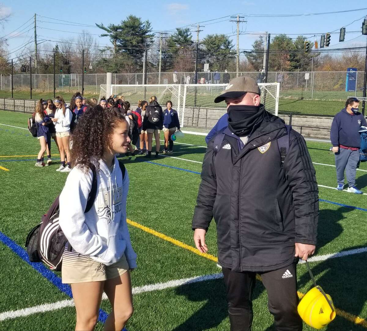 Weston girls soccer coach Gustavo Reaes, right, speaks with Notre Dame-Fairfield senior Toni Domingos after Weston's win over Notre Dame in the SWC South Division championship game Saturday. Domingos concluded her career with 106 goals, a school record.