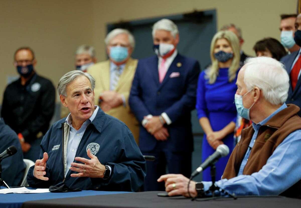 "Gov. Greg Abbott, left, talks with Sen. John Cornyn during a ""Back the Blue"" event inside the Houston Police Officer's Union Headquarters on Wednesday, Oct. 28, 2020, in Houston."