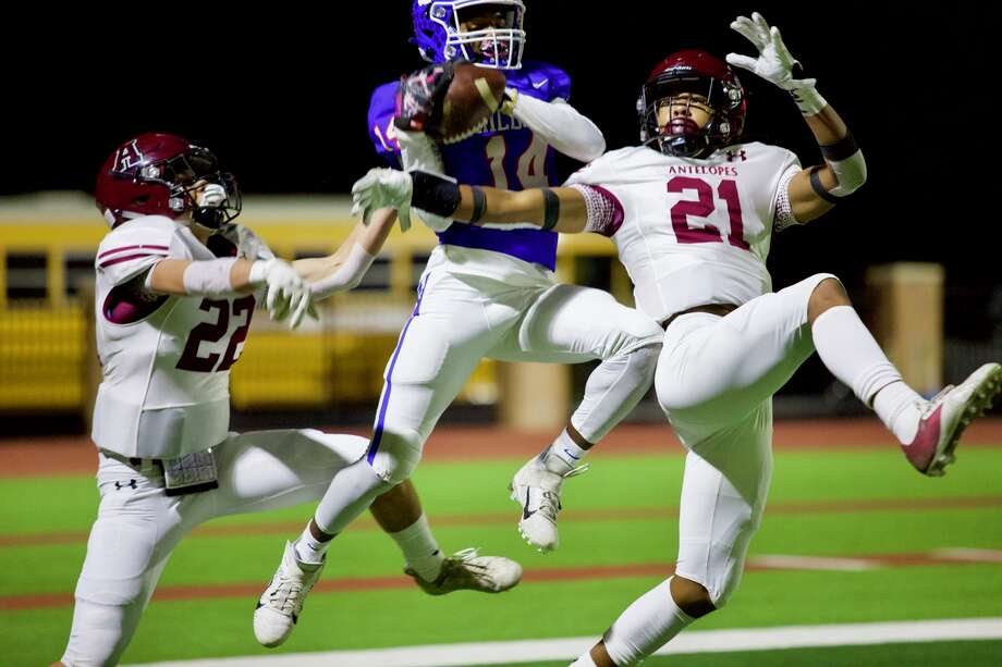 Abernathy defenders Sean Rodriguez (22) and Anthony White try to prevent Childress' Lamont Nickleberry from bringing in the touchdown during their Class 3A Division II bi-district football playoff game on Nov. 13, 2020 in Tyer Stadium in Floydada. Photo: Don Brown/For The Herald