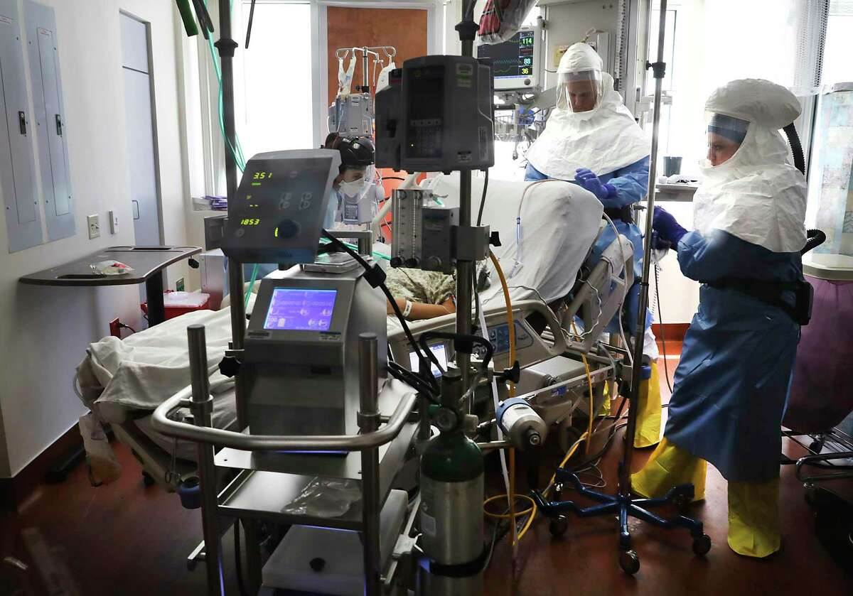 Methodist Hospital Covid Unit personnel prepare a patient for intubation on April 23. The patient is using ECMO equipment, which helps patients by filtering oxygen into their blood. The number of novel coronavirus cases in Bexar County climbed to 69,793 Saturday since the pandemic started in mid-March.
