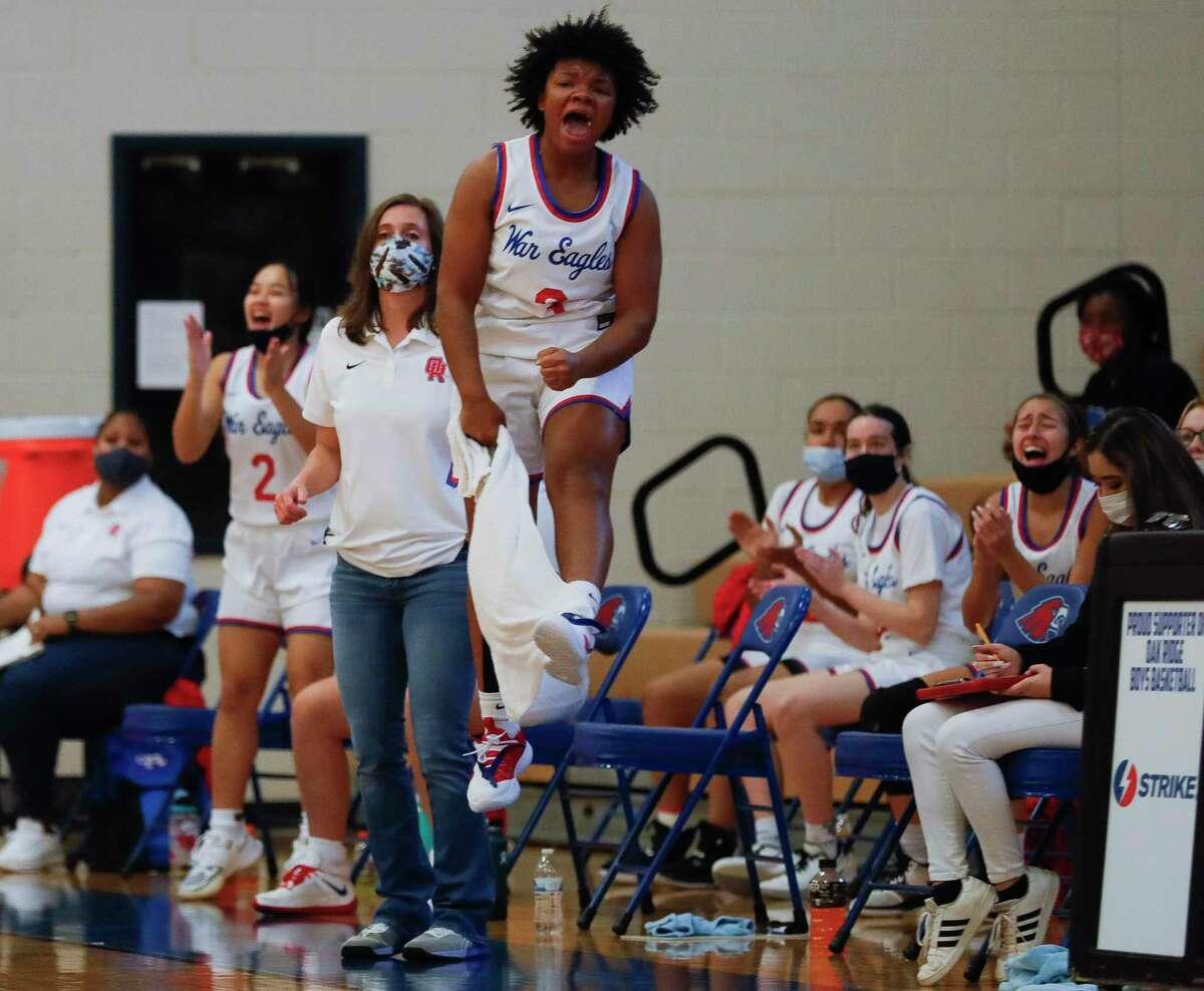 Oak Ridge guard Logan Fuller (3) reacts after a three-pointer by Nikki Petrakovitz during the second quarter of a non-district high school girls basketball game at Oak Ridge High School, Saturday, Nov. 14, 2020.