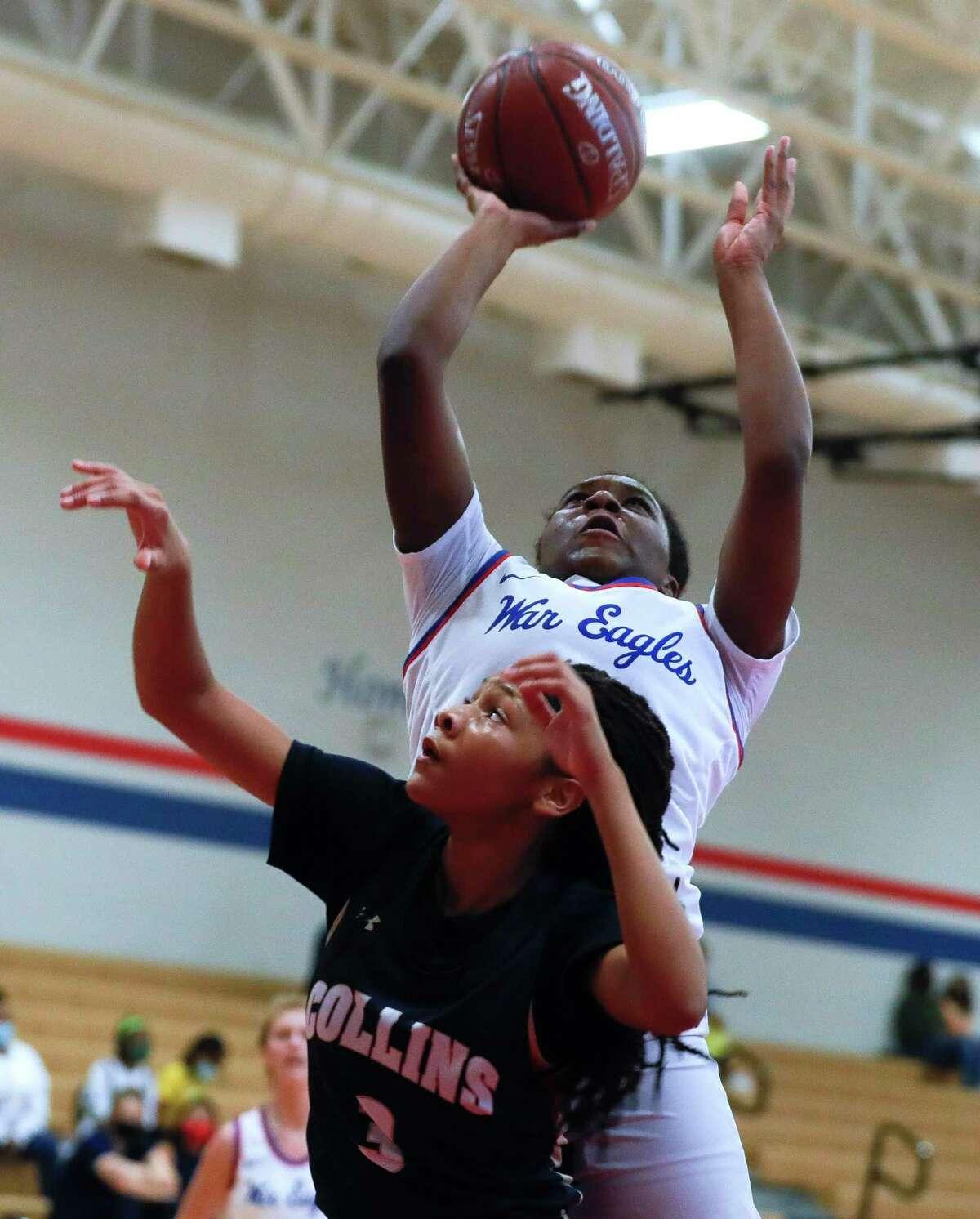 Oak Ridge forward Allison Owens (15) shoots over Klein Collins guard Laila Stewart (2) during the second quarter of a non-district high school girls basketball game at Oak Ridge High School, Saturday, Nov. 14, 2020.