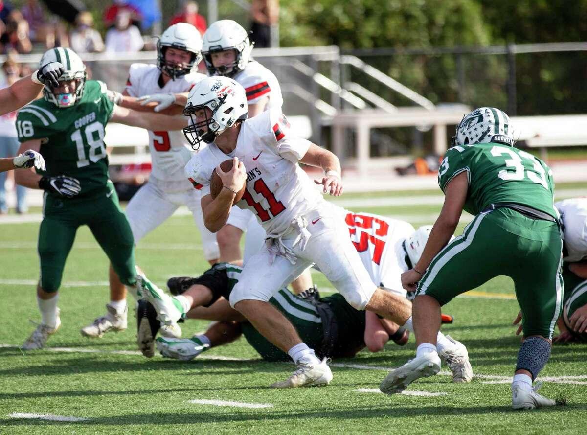St. Johns quarterback John Perdue (11) runs passed John Cooper senior Anthony Giannette (33) during the third quarter of a SPC football game held at The John Cooper School, Saturday, Nov. 14, 2020, in The Woodlands.