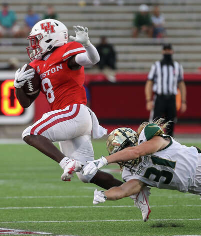 Houston Cougars running back Chandler Smith (8) breaks a tackle by South Florida Bulls defensive back Cody Gentry (31) during the third quarter of an NCAA football game Saturday, Nov. 14, 2020, at TDECU Stadium in Houston. Photo: Jon Shapley/Staff Photographer / © 2020 Houston Chronicle