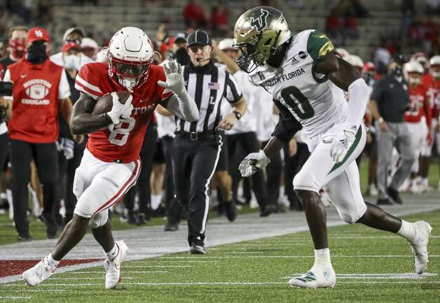 Houston Cougars running back Chandler Smith (8) gets pushed out of bounds by South Florida Bulls defensive back Daquan Evans (0) during the fourth quarter of an NCAA football game Saturday, Nov. 14, 2020, at TDECU Stadium in Houston. Photo: Jon Shapley/Staff Photographer / © 2020 Houston Chronicle
