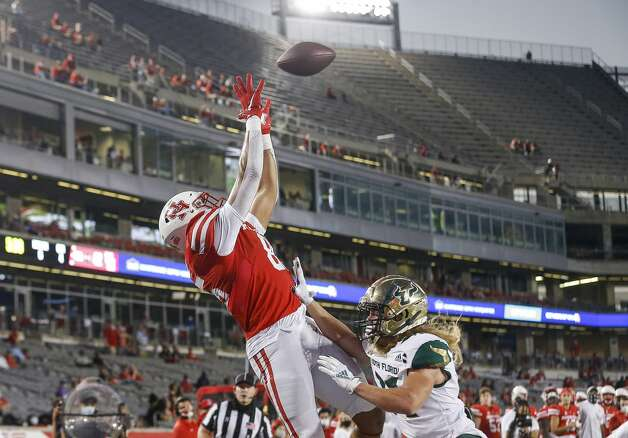 Houston Cougars tight end Christian Trahan (85) catches a touchdown pass defended by South Florida Bulls defensive back Cody Gentry (31) during the fourth quarter of an NCAA football game Saturday, Nov. 14, 2020, at TDECU Stadium in Houston. Photo: Jon Shapley/Staff Photographer / © 2020 Houston Chronicle