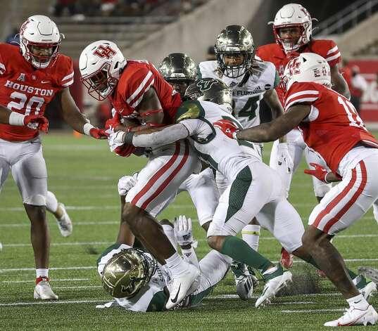Houston Cougars cornerback Shaun Lewis (39) recovers a fumble during the fourth quarter of an NCAA football game Saturday, Nov. 14, 2020, at TDECU Stadium in Houston. Photo: Jon Shapley/Staff Photographer / © 2020 Houston Chronicle