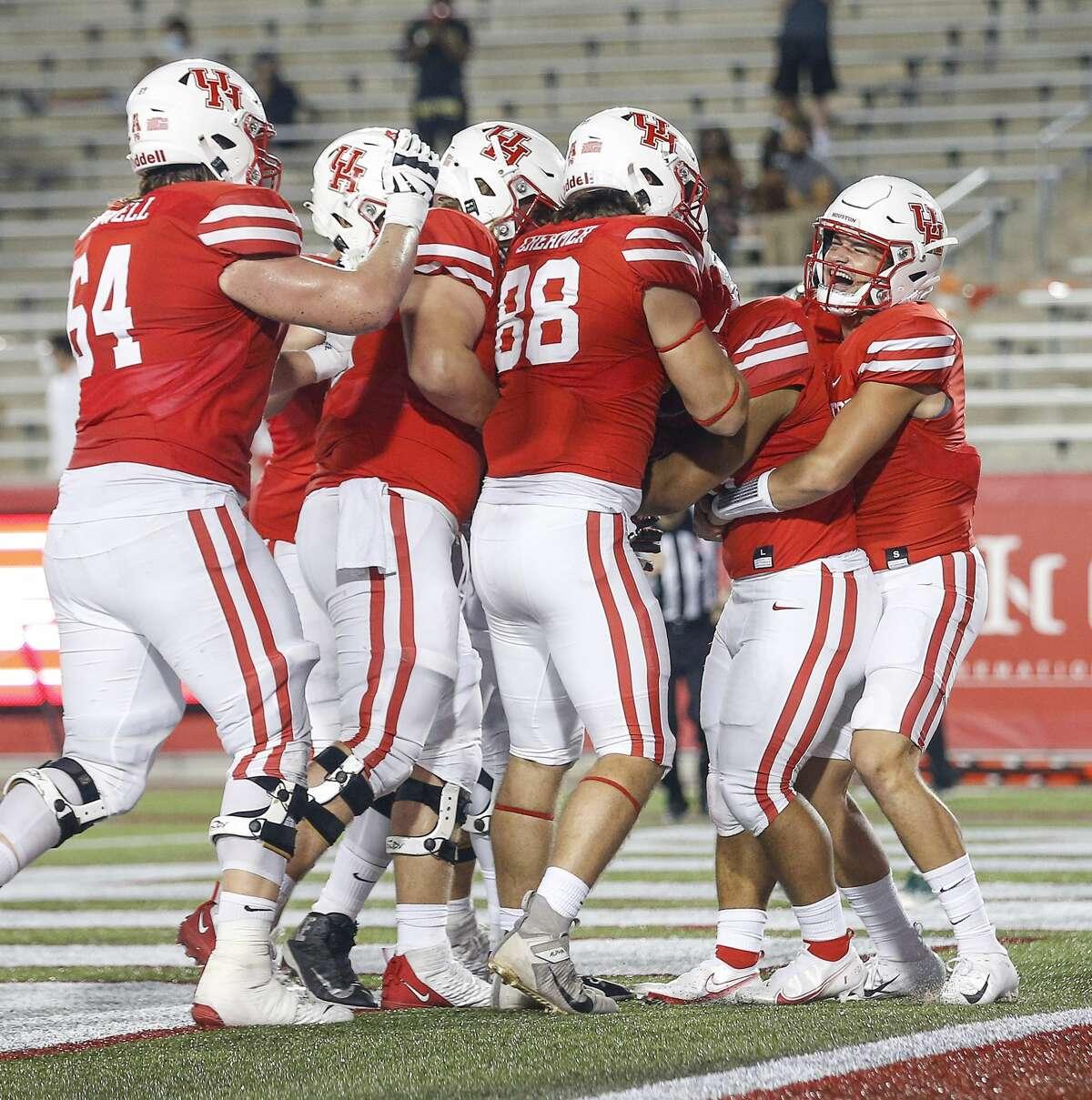 Houston Cougars quarterback Logan Holgorsen (6) celebrates with teammates after Houston Cougars Jame Fullbright, III, (46) scored a touchdown during the fourth quarter of an NCAA football game Saturday, Nov. 14, 2020, at TDECU Stadium in Houston.