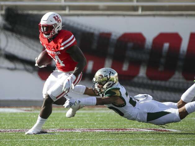 Houston Cougars running back Mulbah Car (34) breaks a tackle by South Florida Bulls defensive back Bentlee Sanders (20) during the first quarter of an NCAA football game Saturday, Nov. 14, 2020, at TDECU Stadium in Houston. Photo: Jon Shapley/Staff Photographer / © 2020 Houston Chronicle