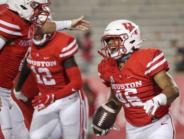 Houston Cougars Jame Fullbright, III, (46) celebrates with teammates after scoring a touchdown during the fourth quarter of an NCAA football game Saturday, Nov. 14, 2020, at TDECU Stadium in Houston. Photo: Jon Shapley/Staff Photographer / © 2020 Houston Chronicle