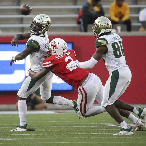 South Florida Bulls quarterback Jordan McCloud (3) passes under pressure by Houston Cougars safety Deontay Anderson (2) to wide receiver Terrence Horne (80) during the third quarter of an NCAA football game Saturday, Nov. 14, 2020, at TDECU Stadium in Houston. Photo: Jon Shapley/Staff Photographer / © 2020 Houston Chronicle