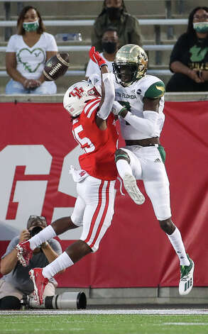 Houston Cougars cornerback D.J. Small (25) is penalized for pass interference on a pass to South Florida Bulls wide receiver Sincere Brown (7) during the fourth quarter of an NCAA football game Saturday, Nov. 14, 2020, at TDECU Stadium in Houston. Photo: Jon Shapley/Staff Photographer / © 2020 Houston Chronicle