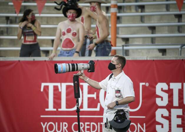 Galveston County Daily News staff photographer Kevin Cox watches game action during the fourth quarter of an NCAA football game Saturday, Nov. 14, 2020, at TDECU Stadium in Houston. Photo: Jon Shapley/Staff Photographer / © 2020 Houston Chronicle