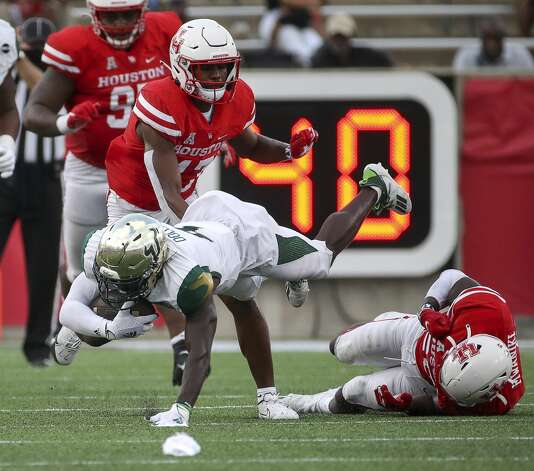 South Florida Bulls wide receiver Omarion Dollison (4) is tackled by Houston Cougars linebacker Jordan Moore (20) during the third quarter of an NCAA football game Saturday, Nov. 14, 2020, at TDECU Stadium in Houston. Photo: Jon Shapley/Staff Photographer / © 2020 Houston Chronicle