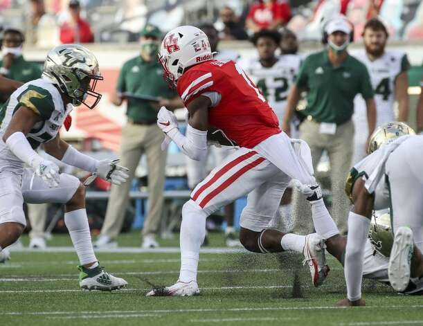 Houston Cougars wide receiver Bryson Smith (1) breaks a tackle by South Florida Bulls defensive tackle Thad Mangum (23) during the third quarter of an NCAA football game Saturday, Nov. 14, 2020, at TDECU Stadium in Houston. Photo: Jon Shapley/Staff Photographer / © 2020 Houston Chronicle