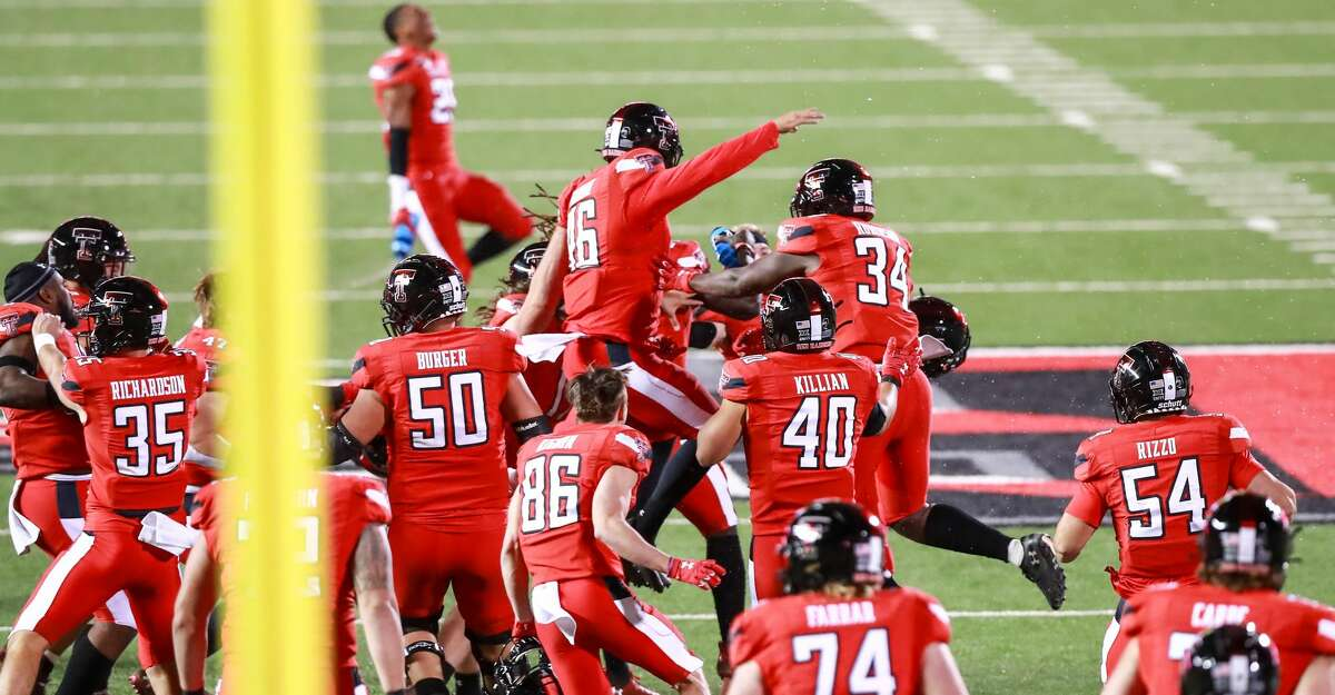The Texas Tech Red Raiders celebrate on the field after the game winning field goal by kicker Jonathan Garibay #46 after the college football game against the Baylor Bears at Jones AT&T Stadium on November 14, 2020 in Lubbock, Texas. (Photo by John E. Moore III/Getty Images)