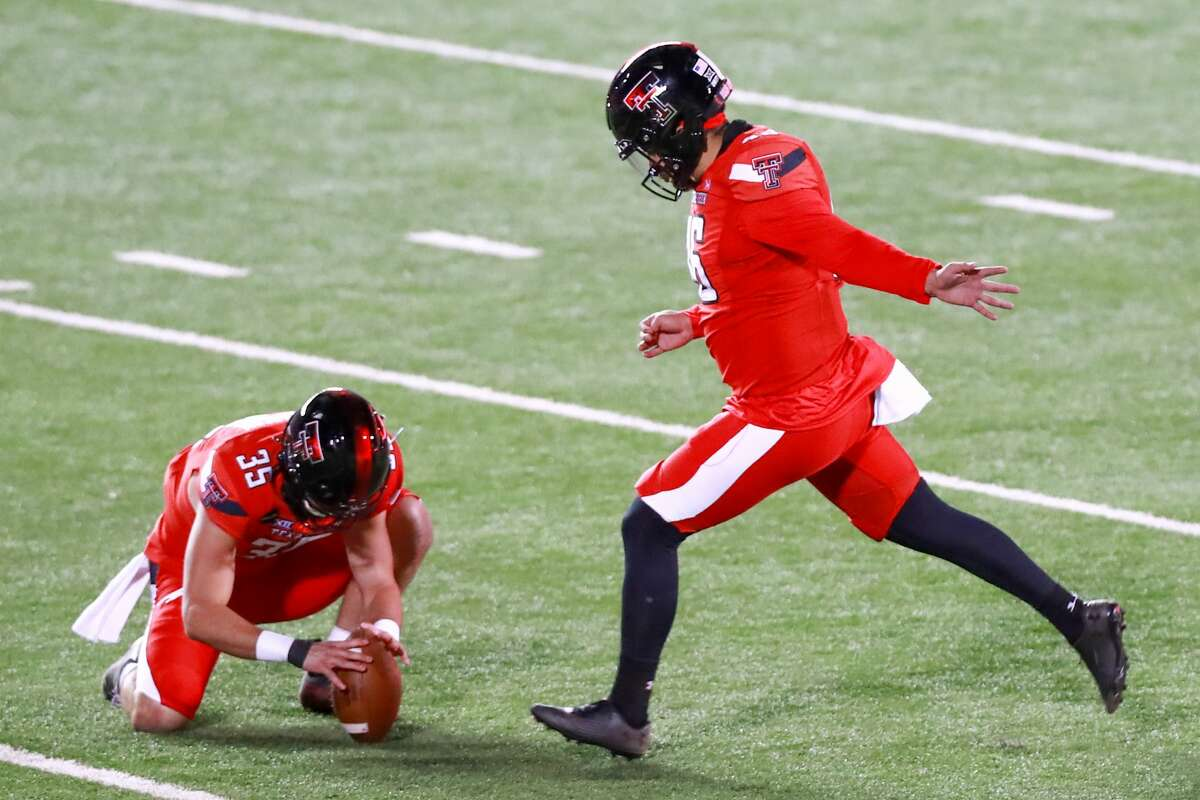 Kicker Jonathan Garibay #46 of the Texas Tech Red Raiders kicks a field goal, held by Mark Richardson #35 during the second half of the college football game against the Baylor Bears at Jones AT&T Stadium on November 14, 2020 in Lubbock, Texas. (Photo by John E. Moore III/Getty Images)