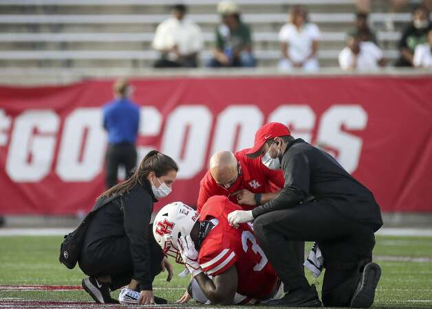 Medical staff attend to Houston Cougars running back Mulbah Car (34) during the second quarter of an NCAA football game Saturday, Nov. 14, 2020, at TDECU Stadium in Houston. Photo: Jon Shapley/Staff Photographer / © 2020 Houston Chronicle