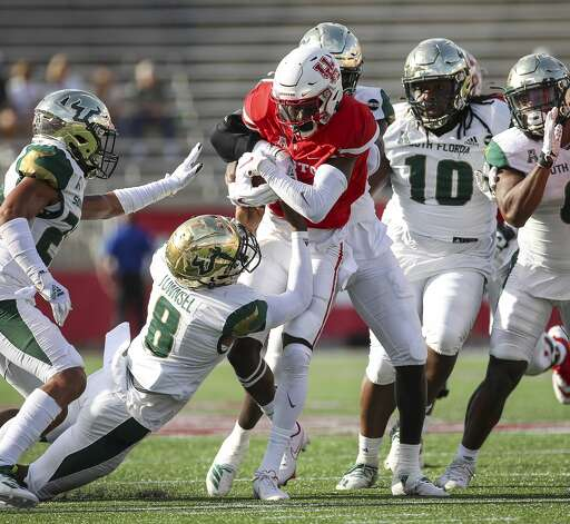 Houston Cougars wide receiver Bryson Smith (1) is tackled by South Florida Bulls defensive back Daquan Evans (0) and defensive back Christopher Townsel (8) during the first quarter of an NCAA football game Saturday, Nov. 14, 2020, at TDECU Stadium in Houston. Photo: Jon Shapley/Staff Photographer / © 2020 Houston Chronicle