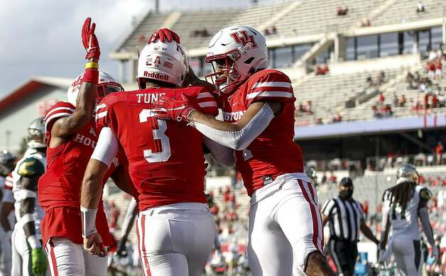 Houston Cougars wide receiver Nathaniel Dell (4) and running back Mulbah Car (34) congratulate quarterback Clayton Tune (3) after he scored a touchdown during the first quarter of an NCAA football game Saturday, Nov. 14, 2020, at TDECU Stadium in Houston. Photo: Jon Shapley/Staff Photographer / © 2020 Houston Chronicle