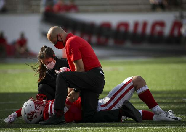 Medical staff attend to Houston Cougars linebacker Jacob Daulong (59) after an injury during the first quarter of an NCAA football game Saturday, Nov. 14, 2020, at TDECU Stadium in Houston. Photo: Jon Shapley/Staff Photographer / © 2020 Houston Chronicle