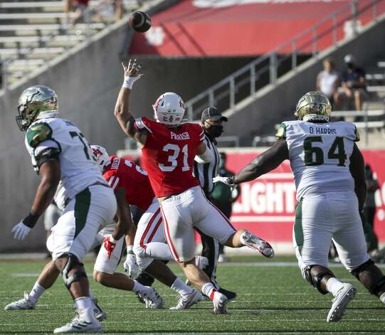 Houston Cougars defensive lineman Derek Parish (31) goes after a deflected pass during the first quarter of an NCAA football game Saturday, Nov. 14, 2020, at TDECU Stadium in Houston. Photo: Jon Shapley/Staff Photographer / © 2020 Houston Chronicle