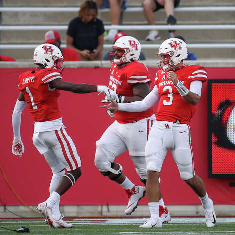 Houston Cougars quarterback Clayton Tune (3) celebrates with wide receiver Bryson Smith (1) after a touchdown during the second quarter of an NCAA football game Saturday, Nov. 14, 2020, at TDECU Stadium in Houston. Photo: Jon Shapley/Staff Photographer / © 2020 Houston Chronicle