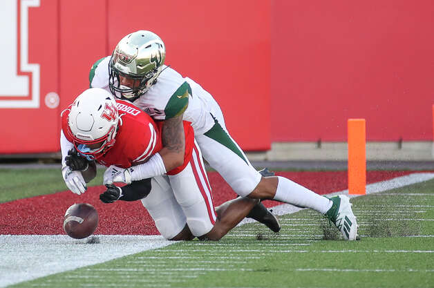 South Florida Bulls defensive back Bentlee Sanders (20) defends a pass against Houston Cougars wide receiver Keith Corbin (2) during the second quarter of an NCAA football game Saturday, Nov. 14, 2020, at TDECU Stadium in Houston. Photo: Jon Shapley/Staff Photographer / © 2020 Houston Chronicle