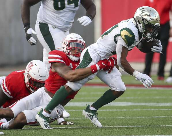 South Florida Bulls running back Brian Battie (21) is tackled by Houston Cougars linebacker Mannie Nunnery (14) during the second quarter of an NCAA football game Saturday, Nov. 14, 2020, at TDECU Stadium in Houston. Photo: Jon Shapley/Staff Photographer / © 2020 Houston Chronicle