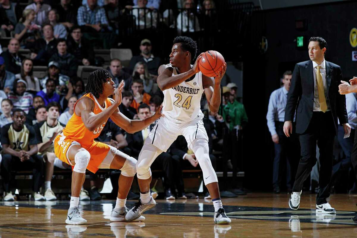 NASHVILLE, TN - JANUARY 23: Aaron Nesmith #24 of the Vanderbilt Commodores handles the ball against Yves Pons #35 of the Tennessee Volunteers during the game at Memorial Gym on January 23, 2019 in Nashville, Tennessee. Tennessee won 88-83 in overtime. (Photo by Joe Robbins/Getty Images)