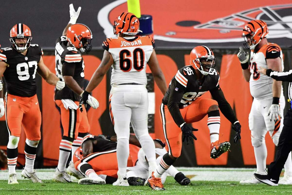 The Browns' Myles Garrett (95) celebrates after sacking quarterback Bengals Joe Burrow and forcing a fumble.