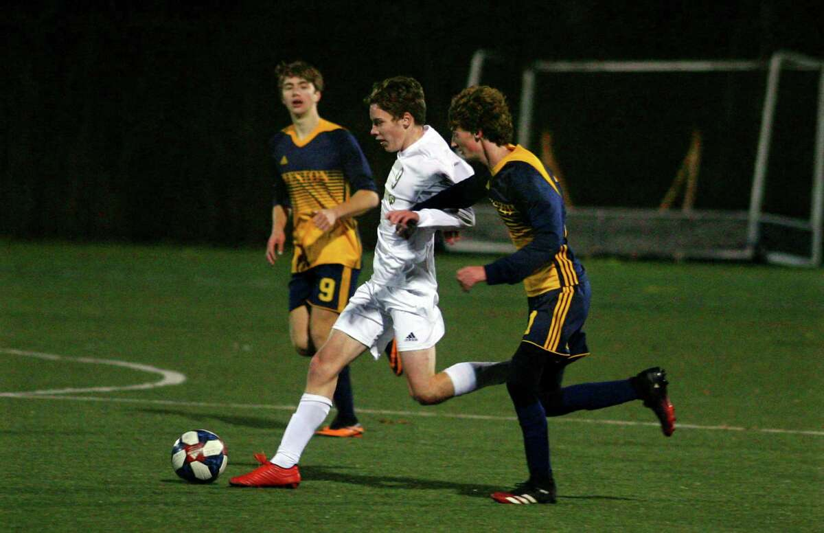 Joel Barlow's Rice Davis reaches the ball ahead of Weston's Brandon Leuzzi during SWC South Boys Soccer championship action in Weston, Conn., on Saturday Nov. 14, 2020.