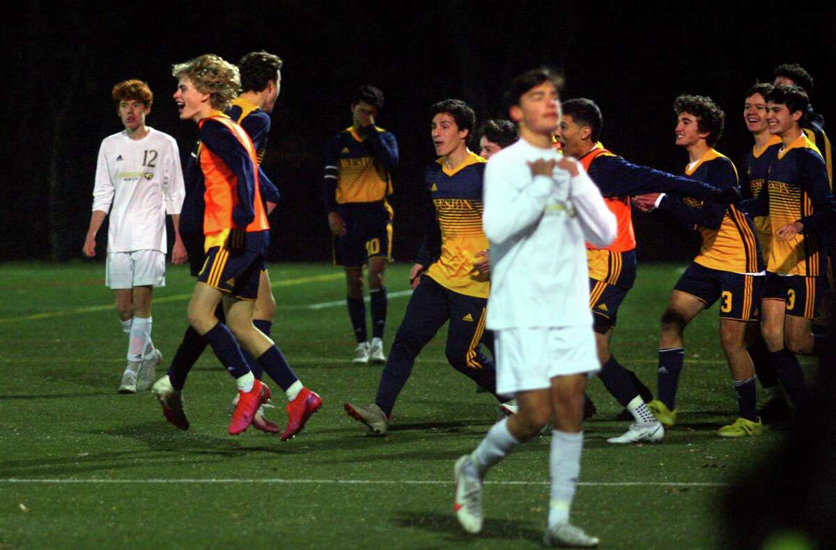 Weston celebrates its 2-1 win over Joel Barlow in SWC South Boys Soccer championship action in Weston, Conn., on Saturday Nov. 14, 2020.
