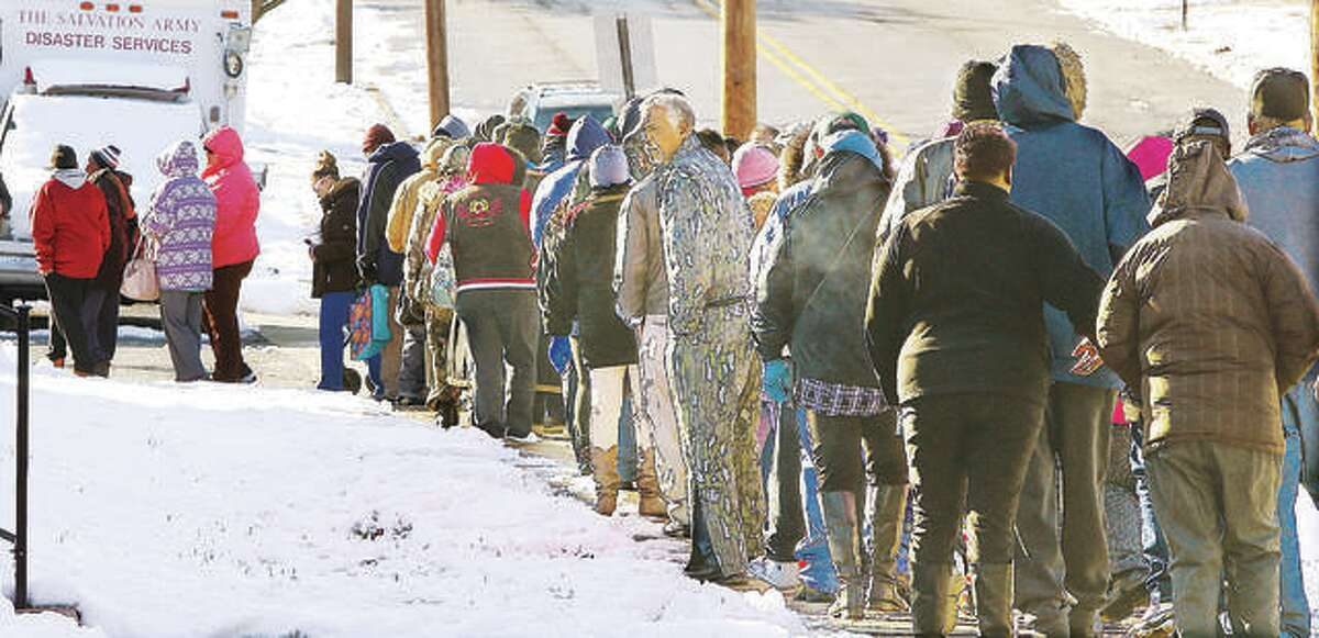 In this 2018 file photo, a large crowd was lined up Friday morning in front of the Alton Salvation Army in the 500 block of Alby Street for the TorHoerman Law Firm's annual turkey giveaway last year. People started lining up for the event two hours ahead of time. The Edwardsville firm had 500 turkeys to give away this year.