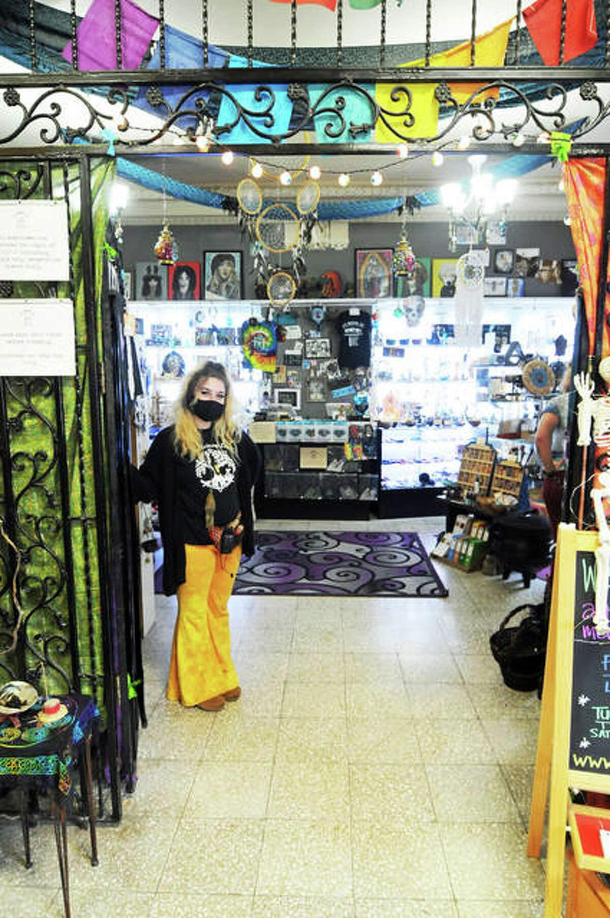 It's Raining Zen's manager, Laura McKeever, stands inside the store located at 301 E. Broadway at Historic Mineral Springs, in Downtown Alton.