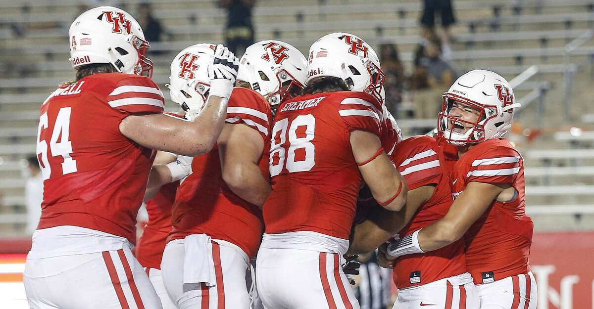 Houston Cougars quarterback Logan Holgorsen (6) celebrates with teammates after Houston Cougars Jame Fullbright, III, (46) scored a touchdown during the fourth quarter of an NCAA football game Saturday, Nov. 14, 2020, at TDECU Stadium in Houston.