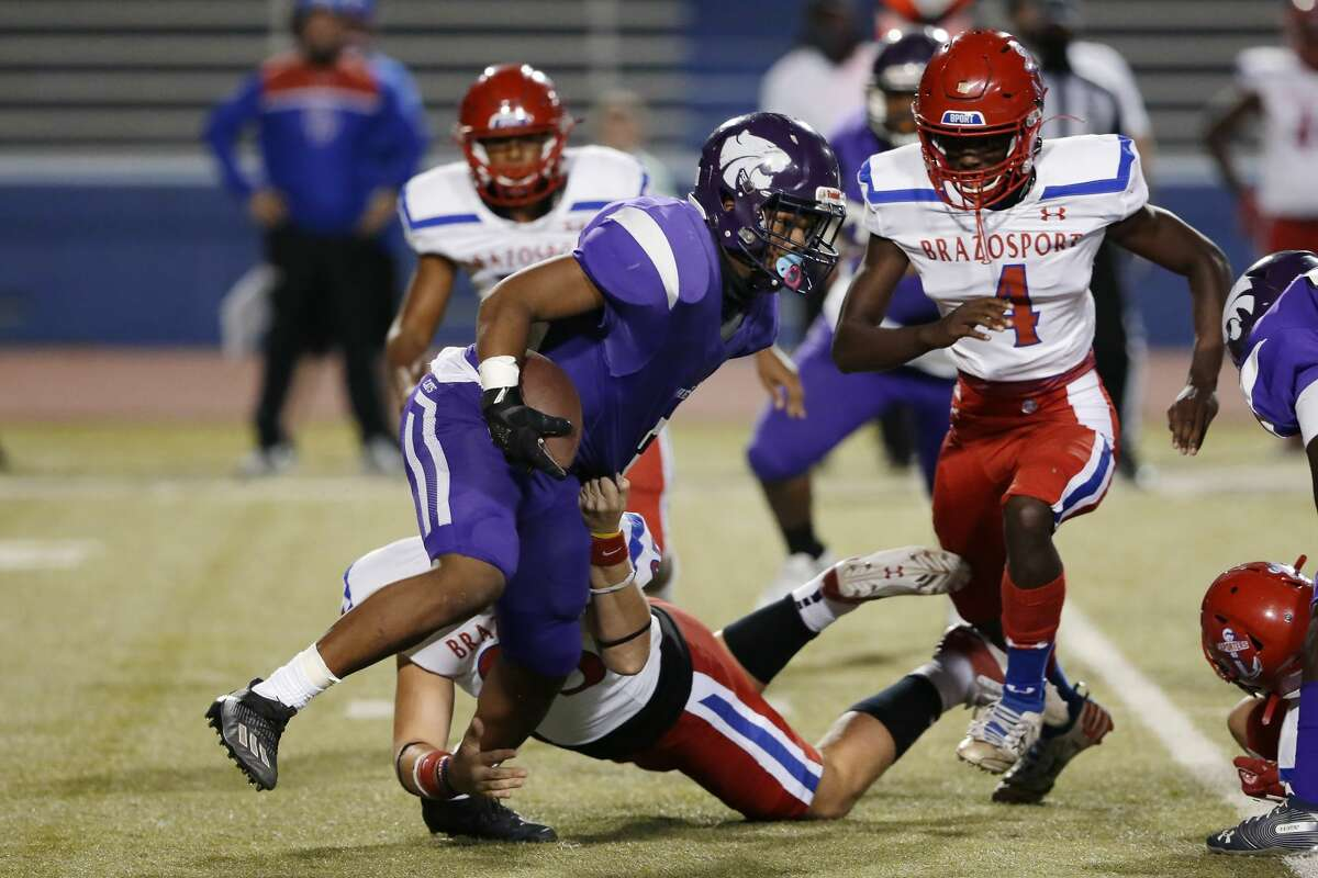 Wheatley Wildcats receiver Jaquell Bonner, front, is caught by Brazosport Exporters' Christian Scharrer during the first half of a high school football game at Barnett Stadium Saturday, Nov. 14, 2020 in Houston, TX.