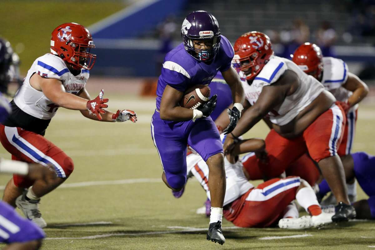 Wheatley Wildcats receiver Jaquell Bonner, middle, makes a gain against the Brazosport Exporters during the first half of a high school football game at Barnett Stadium Saturday, Nov. 14, 2020 in Houston, TX.