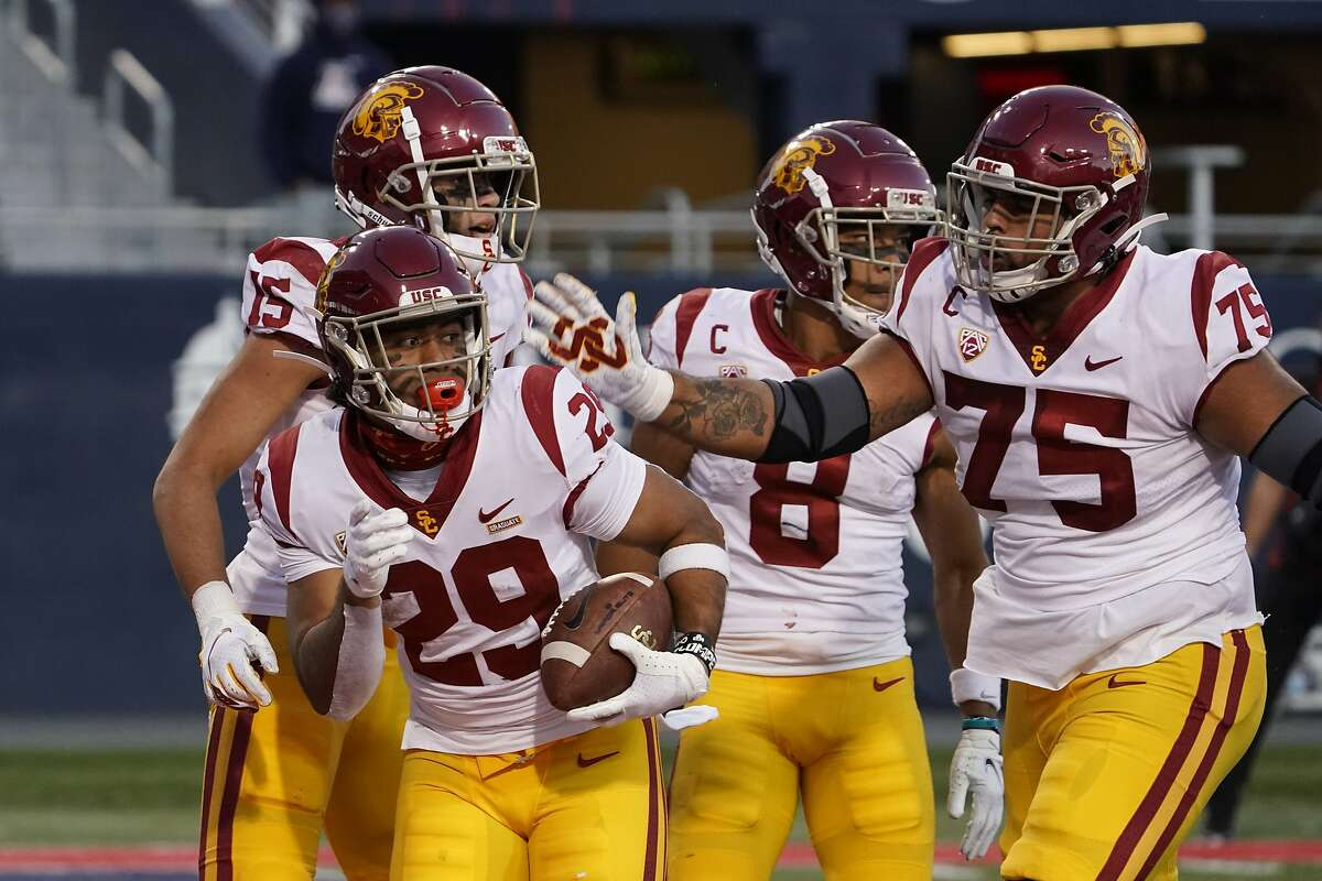 USC running back Vavae Malepeai (29) celebrates with teammates after scoring a touchdown in the final minute of Saturday's game in Tucson, Ariz. Malepeai capped a 75-yard drive by carrying defenders with him into the end zone.