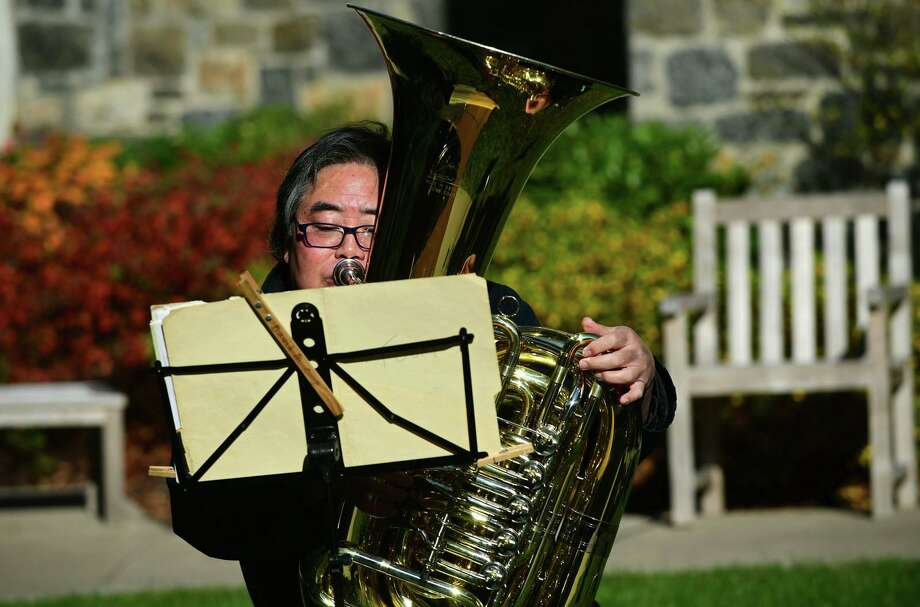 Tuba player Morris Kainuma of The Greenwich Symphony Orchestra Brass Quintet perform a special outdoor concert at The Nathaniel Witherell for senior residents and staff Saturday, November 14, 2020, in Greenwich, Conn. The performance was outdoors and residents and staff enjoyed the concert through the facility's courtyard windows Photo: Erik Trautmann / Hearst Connecticut Media / Norwalk Hour