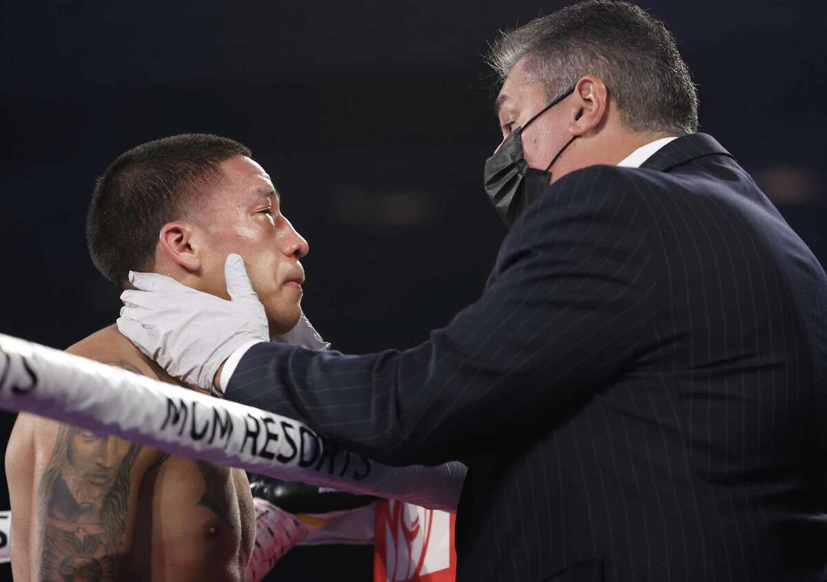 LAS VEGAS, NV - NOVEMBER 14: Joshua Franco swollen eye checked by doctor during his fight with Andrew Moloney for the WBA super flyweight title at the MGM Grand Conference Center on November 14, 2020 in Las Vegas, Nevada. (Photo by Mikey Williams/Top Rank Inc via Getty Images)
