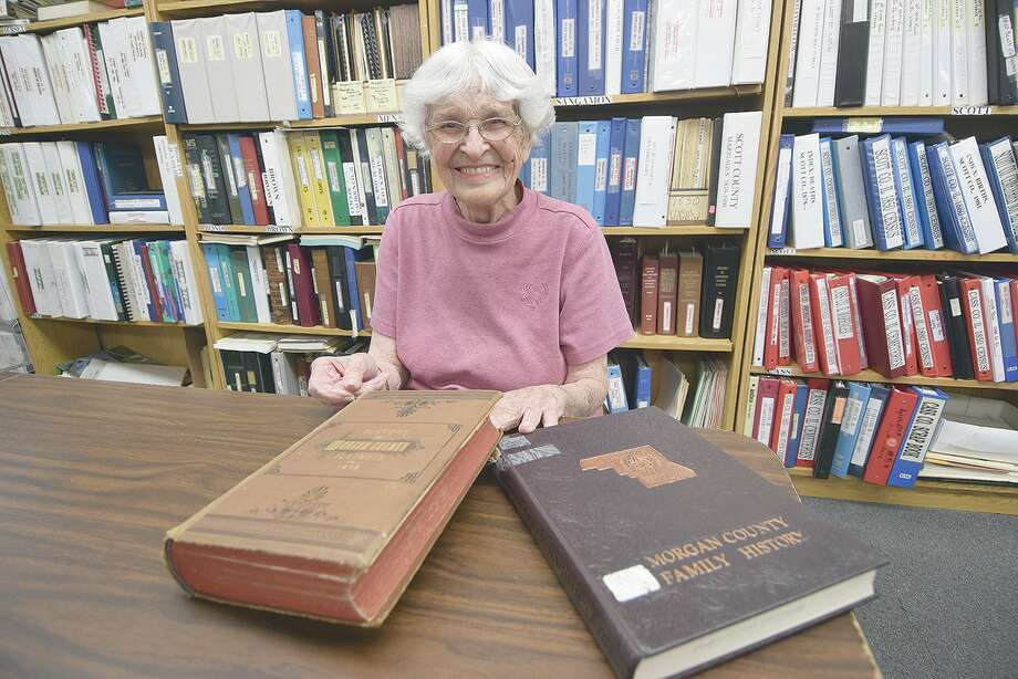Elizabeth Hardy with an 1878 Morgan County reference, one of the most-sed records at the Jacksonville Area Genealogy and Historical Society. Photo: David Blanchette   Journal-Courier